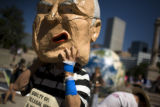 John Russell of Boulder puts on a Dick Cheney mask to help the Backbone Campaign with a puppet...