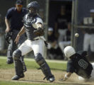 (Englewood, Colo., May 13, 2005) Ralston Valley Mustangs catcher Levi Tapia can't make the tag at...