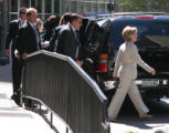 (026) Hillary Clinton waves to her supporters as she walks to her car followed by the secret...