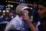 Kathy Ensz of Greeley, CO, laughs as she gets a donkey temporary tattoo on her cheek at the 2008...