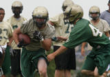 Tommy Flannagan, R-makes his move at practice at Bear Creek HS, Tuesday August 12, 2008.  Class...