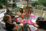 (from left to right) Jim Phillips (cq) shares breakfast with family at their home in Denver, as...