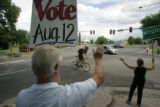 (seqn) Volunteers Tom Chase, CQ,  and Anne O'Sullivan, CQ, encourage voting while supporting their...
