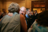 (seqn) Colorado Secretary of State Mike Coffman gets a warm hug from a supporter after addressing...