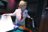 After the polls closed Joy Myers-Barklage hurries to hang signs befor the candidate Wil Armstrong...