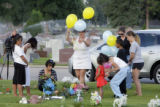 DM8872  People gather with balloons, flowers and stuffed animals at the gravesite of Chandler...