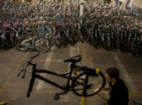 Kevin Flynn of Bicycle Village assembles one of 1,000 bikes that Humana and Bikes Belong are...