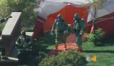 The FBI, in conjunction with Hazmat and the Denver National Guard, prepare to enter an apartment...
