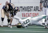 Colorado Crush defensive specialist, Delvin Hughley (left #2) breaks free from a tackle attempt by...