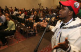 54419 Idris Ogunjobi, 24, from Alaska, address a panel of scholars on the subject on Hip Hop,...
