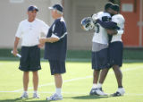 Dallas Cowboys head coach Mike Shanahan and Dallas Cowboys head coach Wade Phillips, left, chat as...