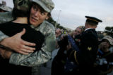 Matthis Chirouz, of the New York City chapter of Iraq Veterans Against the War, hugs Robynn Murray...
