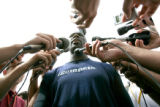 (seqn) Dallas Cowboys Terrell Owens talks to the media after the Denver Broncos practice with the...