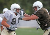 University of Wyoming defensive end, John Fletcher tries to get past offensive tackle, Garrett...