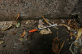 1773  A discarded syringe lies in a corner of the Greek Amphitheater in Civic Center Park in...
