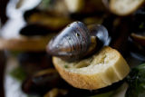 Mariniere Mussels in a white wine sauce for $11 are served at Cheeky Monk Belgian Beer Cafe on...