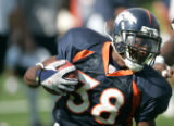 (seqn) Denver Broncos Anthony Alridge takes off down field during practice with the Dallas Cowboys...