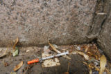 1817  A discarded syringe lies in a corner of the Greek Amphitheater in Civic Center Park in...