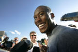 (seqn) Denver Broncos Brandon Marshall answers questions about a sign on he put on his pads to...