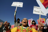 Garcia Molina de Pick, of San Diego, chants during an immigrant rights march to Lincoln Park on...