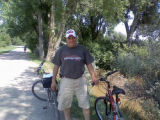 Penn delegate Mike Butera takes break from his Thurs. bike ride on Highline Canal