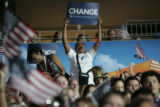Spectators react to Democratic Presidential nominee Sen. Barack Obama's speech at Invesco Field at...