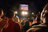 (326)  Obama supporters cheer at a block party Thursday, August 28, 2008, watching a TV feed on a...