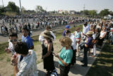 Spectators cue up into large lines outside Invesco Field at Mile High for the final day of the...