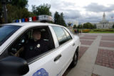 6802  A Denver Police officer sits in his cruiser as he patrols Civic Center Park in Denver....