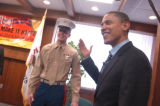 U.S. Sen. Barack Obama (D-Ill.), right, motions to U.S. Marine Cpl. Seamus Ahern of Silvis prior...