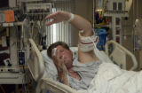 Ryan Balzer,27, (RIGHT and in bed) discusses his ordeal surviving a kayak accident while rafting...