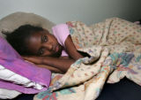 Kalole Knight (cq), 11, lays down in her bunk bed while staying on the family floor of the...