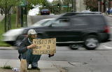 Leland Doane (cq) panhandles at the corner of Broadway and 14th Ave. in Denver, Colo., on...