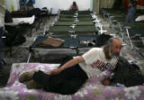 Paul Chavez (cq), 51, prepares to sleep on a cot at the Denver Rescue Mission in Denver, Colo., on...