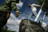 MJM209 Workers, Salvador Diaz (cq), 21, left, and Connor Burke (cq), 17, right,  load trees onto a...