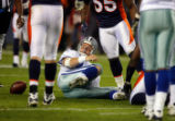 DM0431  Dallas Cowboys quarterback Brad Johnson picks himself up off the ground after being sacked...