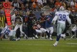 in the first quarter as the Denver Broncos play the Dallas Cowboys in the first preseason game at...