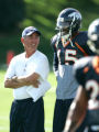Denver Broncos head coach Mike Shanahan smiles with Brandon Marshall who put a sign on his pads to...