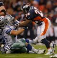 DM0285  Denver running back Andre Hall puts a hand in the face of Dallas Cowboys linebacker Zach...