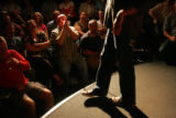The audience at the Comedy Works laugh at comedian Chris Voth on stage on Friday, August 22, 2008....