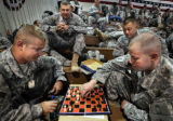 SSgt. Philip(CQ) Wedge,left and SSgt. Brian McCraney played a game of chess as Sgt, William...