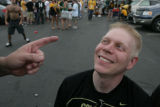 Matt Benson, 28, (cq) a CU fan listens to a lecture from Ed Becker (cq) a CSU fan during a...
