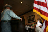 MJM157 Former POW and Vietnam War veteran, Rod Knutson (cq), left, speaks during the weekly...