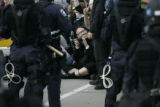 Protesters face off with police in riot gear in downtown St. Paul on the final day of the...