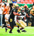 DM0325  CU's Ryan Walters breaks up a pass to xxxx in the first quarter as the Colorado State...