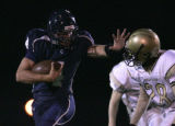 #4 Danny Spond (cq) runs as the Columbine Rebels football team beats the Thomas Jefferson Spartans...