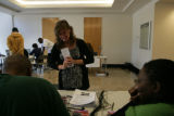 Volunteers work with the Obama campaign to credential people that have won the lottery to watch...