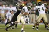 DM1561  CU's Brad Jones chases down and sacks CSU quarterback Billy Farris  on fourth down in the...