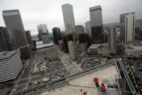Workers finish up a balcony on the 25th floor of One Lincoln Center in downtown Denver Friday,...