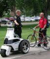 Officer Chris Melvin of the Colorado State University Police Department speaks with a bicyclist on...